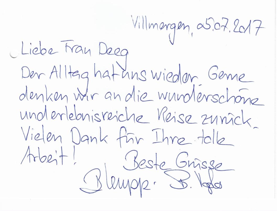"""Text auf der Postkarte: """"Liebe Frau Deeg, der Alltag hat uns wieder. Gerne denken wir an die wunderschöne und erlebnisreiche Reise zurück. Vielen Dank für  Ihre tolle Arbeit!"""""""